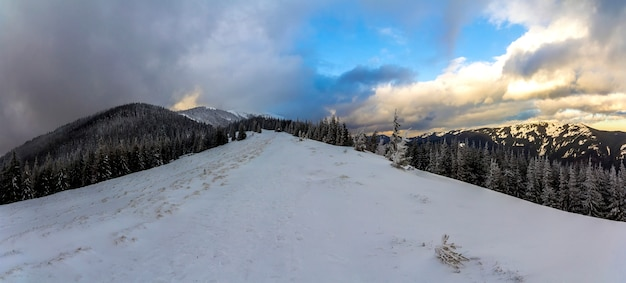 Winter snow-covered mountains panoramic view.