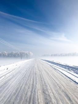 Winter snowfall. snowy road