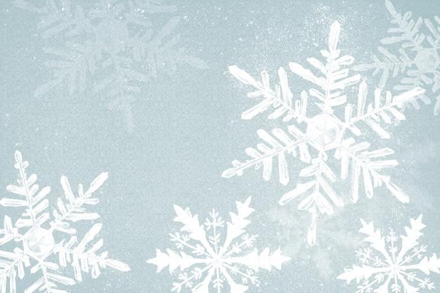 파란색 배경에 겨울 눈송이 그림