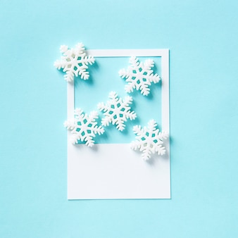 Winter snowflake on a paper frame