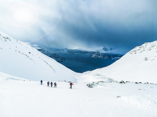 Winter sport, group walking in snow, skitouring, norway fjord