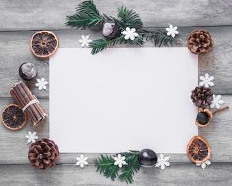 Winter symbols around paper sheet