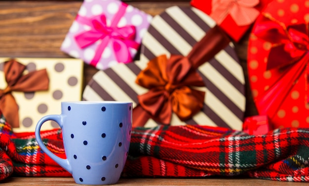 Winter tea in a cup and christmas gifts