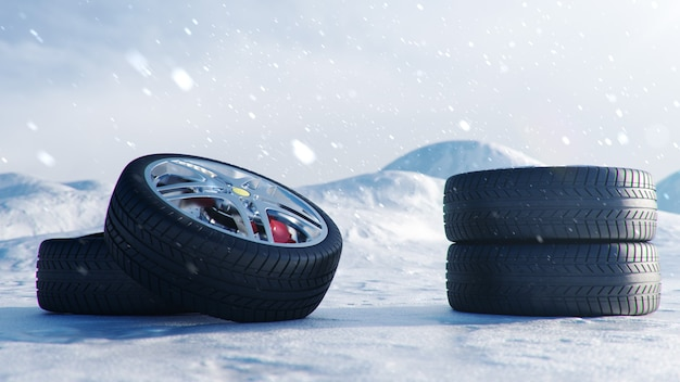 Winter tires on background snowstorm, snowfall and slippery winter road. winter concept road safety