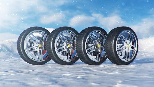 青空の背景、降雪、滑りやすい冬の道の冬用タイヤ。冬のコンセプトの交通安全