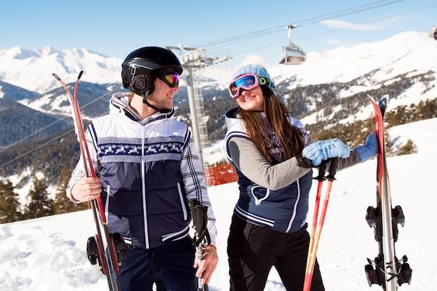 Winter vacation - portrait of skiers in ski resort.