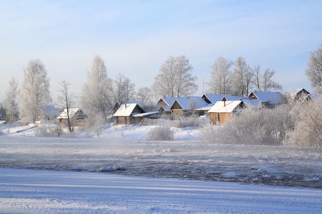 Winter village on coast river