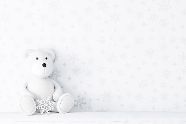 冬の白い背景とクマのぬいぐるみ