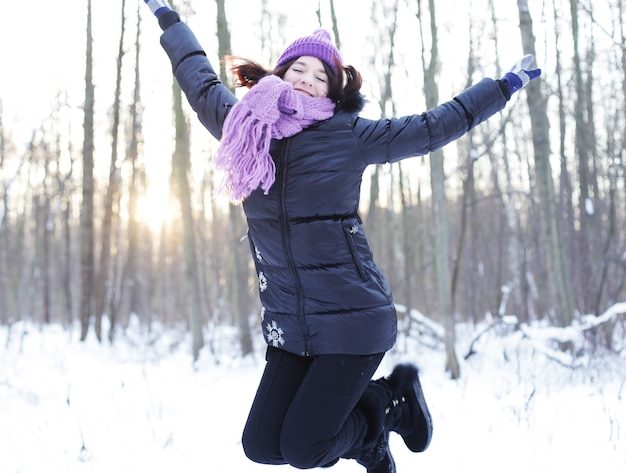 Winter woman jump in park