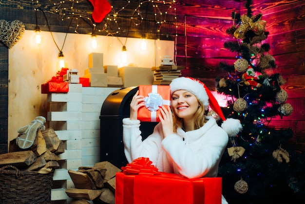 Winter woman wearing red santa claus hat merry christmas and happy new year christmas decorations an...