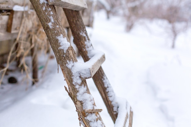 Winter, wooden stairs on the street, covered with snow.
