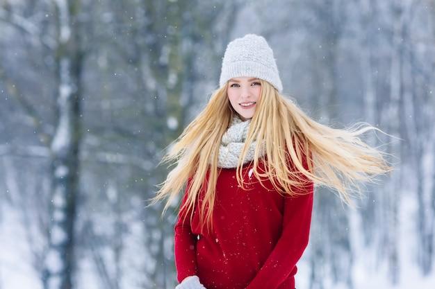 Winter young teen girl portrait. beauty joyful model girl laughing and having fun in winter park