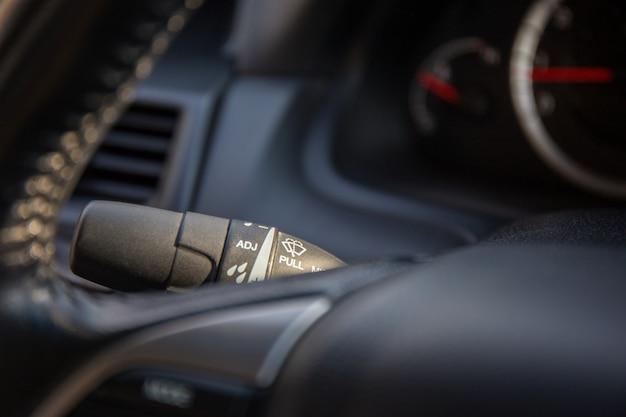Wiper control stem between gauge mile and steering wheel