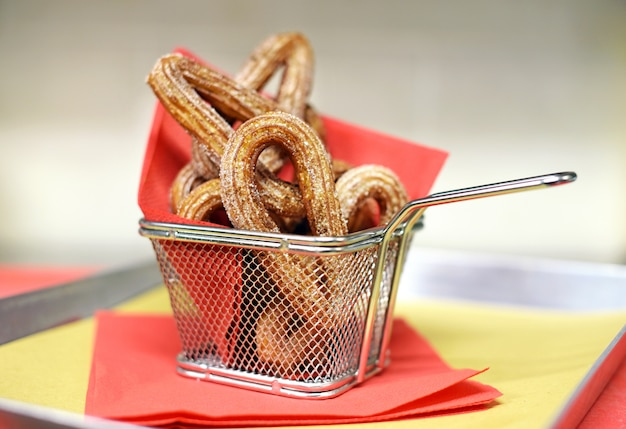 Wire basket of crunchy churros pastries