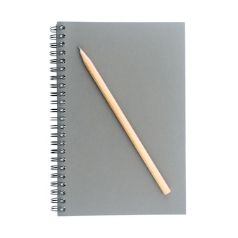 Wire bound or spiral bound sketchbook made from grey board and wood pencil isolated on white background.