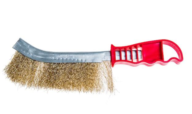 Металлический инструмент проволочной щетки для удаления деревенского, изолированного на белом