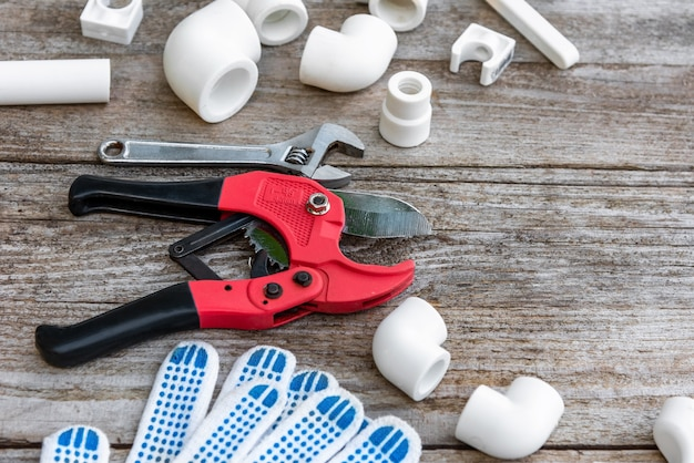 Wire cutters and gloves for polypropylene pipes.