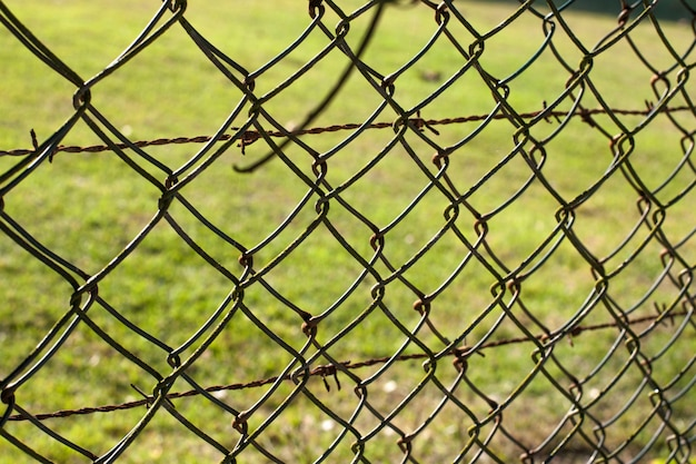 Wire fence (cyclone fencing) in repeating patterns