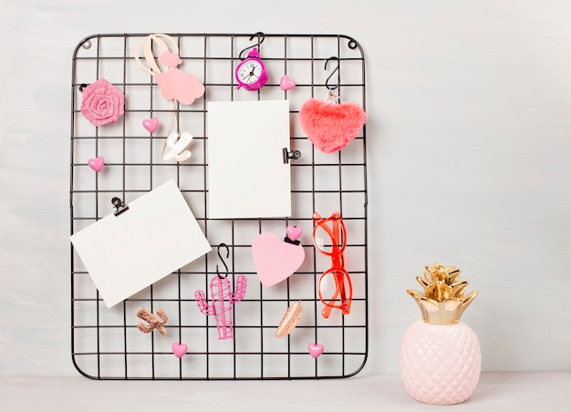 Wire grid board with girl's accessories and cards for inspirational quotes