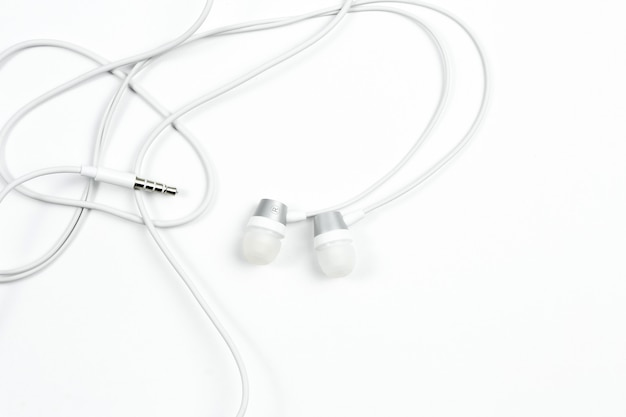 Wired headphones on white isolated background