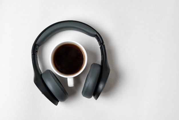 Wireless full-size headphones and a cup of coffee. directly above