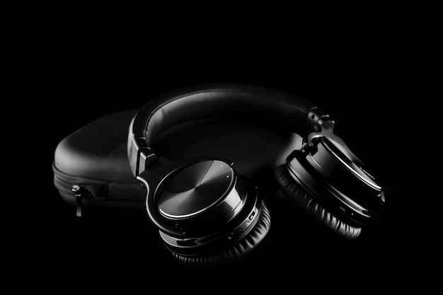Wireless headphones on black isolated