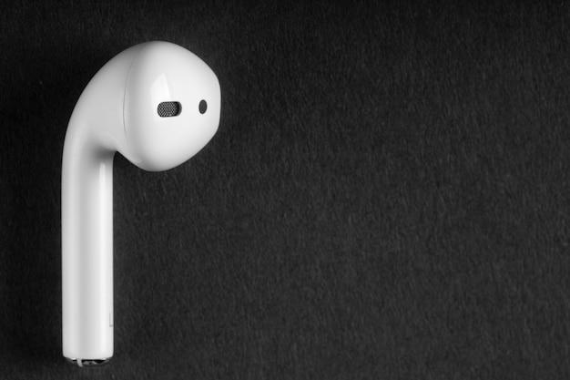 Wireless headphones on black surface