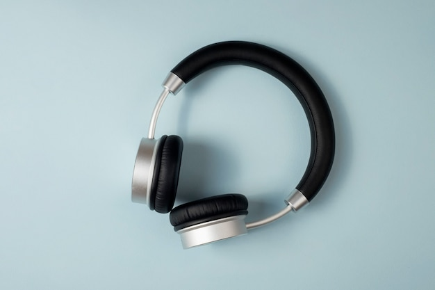 Wireless headphones on blue background. the view from the top.