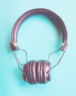 Wireless headphones on colorful blue background.