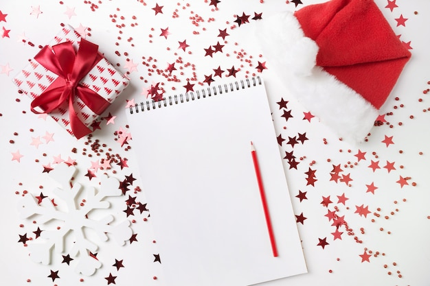 Wish list for christmas and new year. new 2020 year plan and to do list with red holiday decor.