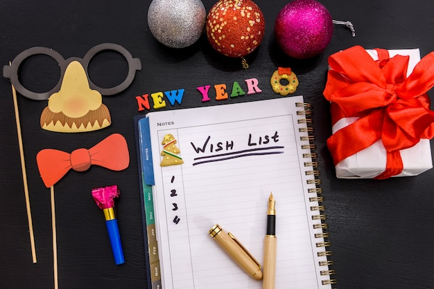 Wish list in notepad on the table