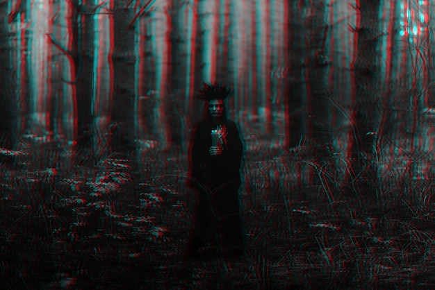Witch in a black costume performs dark spells with candles. black and white with 3d glitch virtual reality effect