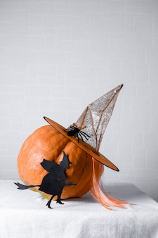 Witch of black paper diy with an orange pumpkin wearing a witch hat
