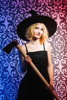 Witch holding axe and smiling