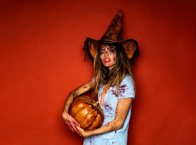 Witch with pumpkin wild people piece of meat full of blood