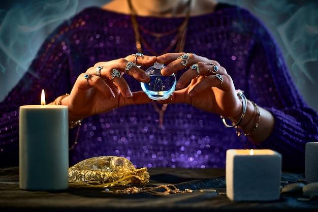 Witch woman using enchanting elixir potion bottle for love spell, magical witchcraft and divination. magic illustration and alchemy