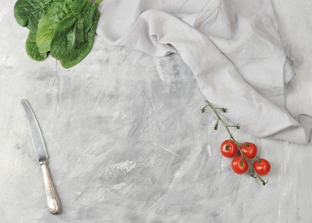 With a blank space for text and a branch of cherry tomatoes