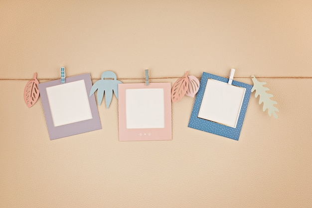 With colorful picture frames hanging on the rope with copy space for text and photos