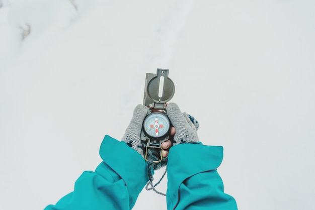 With compass in winter