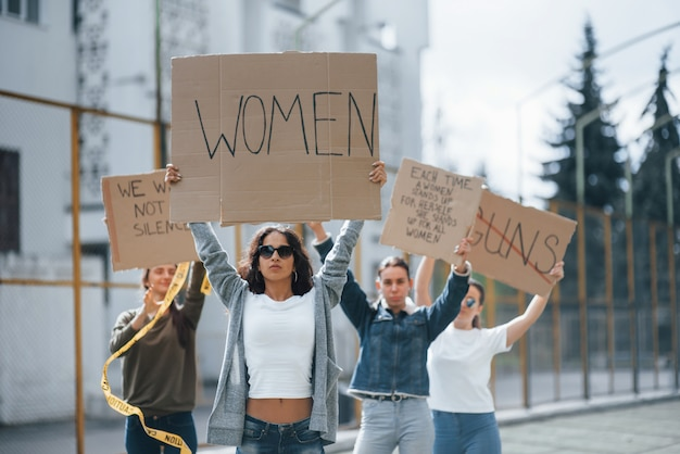 With hands up. group of feminist women have protest for their rights outdoors