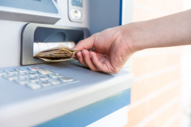 Withdraw cash from an atm