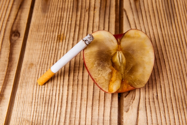 Withered apple and cigarettes represent a bad influence.