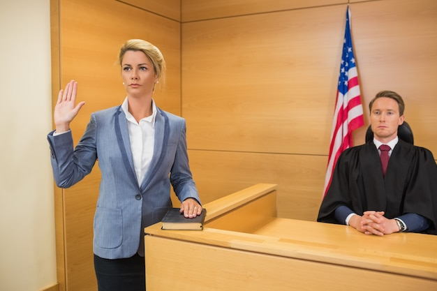 Witness taking an oath