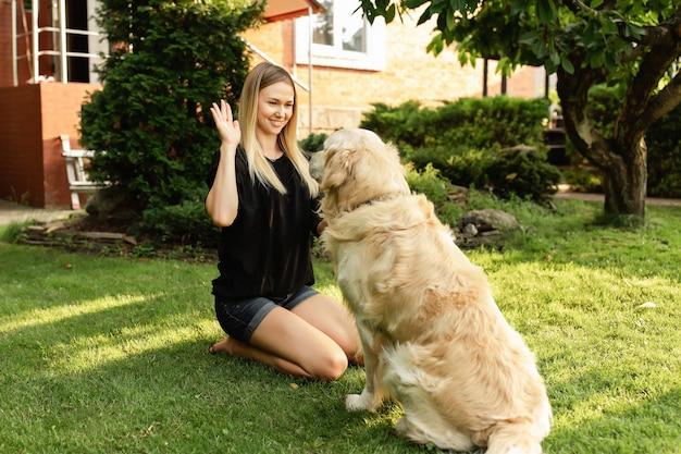 Woamn and dog labrador outdoors