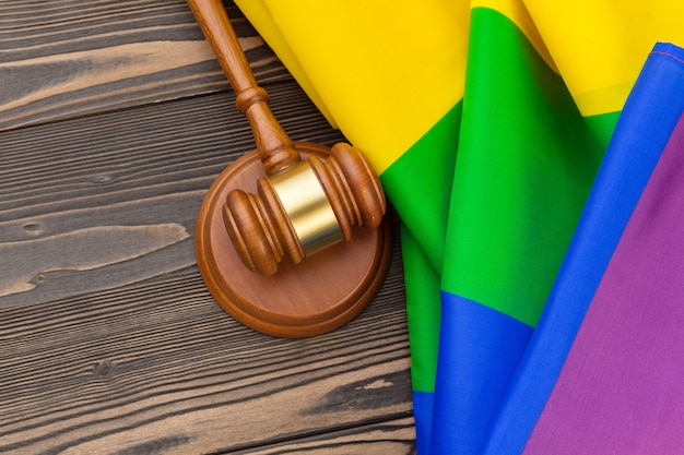 Woden judge mallet, law and justice with lgbt flag in rainbow colors