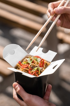 Wok in box in black food container
