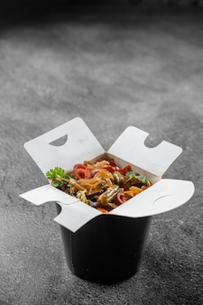 Wok in box rice noodles in black food container
