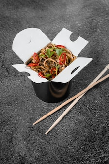 Wok in box spicy noodles in black food container