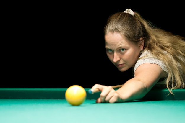 Woma playing billiards
