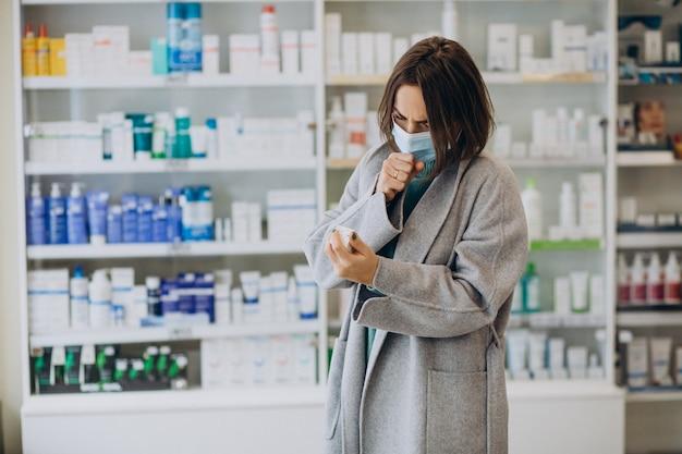 Womam customer with headache at pharmacy